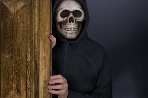 Halloween theme of man with skull