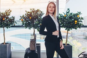 Young businesswoman standing in
