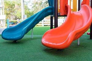 plastic slide on yard in park