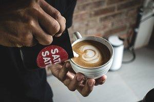 Barista making a perfect latte art