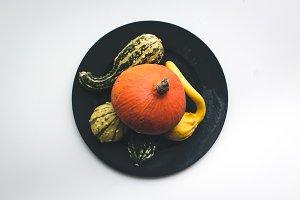 Autumn pumpkins on a plate