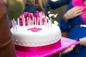 Birthday celebration with pink cake