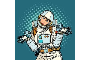 woman astronaut with dumbbells