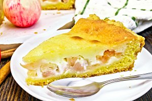 Pie apple with sour cream in plate