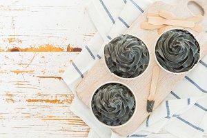 Black ice cream in white cups