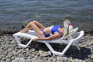 A beautiful girl in a blue bikini