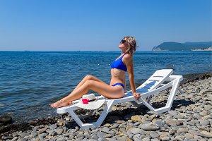 Beautiful girl in a blue bikini and
