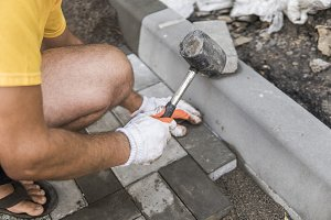 Hands of a builder in his orange