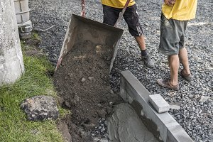 Worker used wheelbarrow for