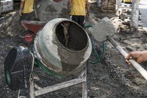 Construction worker add ingredients