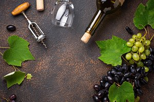 Grape, wine and vintage corkscrew
