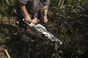 Lumberjack logger worker in cutting