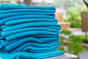 Stack roll of bath blue towels