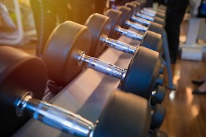 dumbbells in the gym at sports club