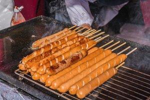 Pork sausages grilling