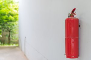 Fire Extinguisher on white wall