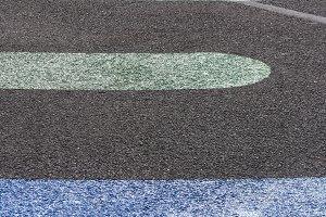 Colored line shapes on asphalt