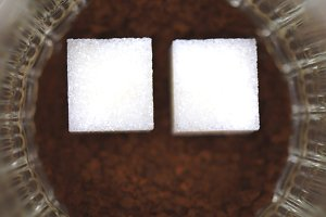 Two pieces of sugar in a glass