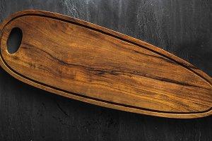 Empty wooden long board for serving