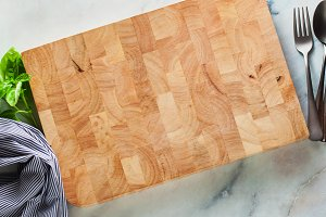 wooden board for cutting on a marble