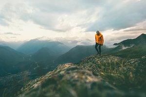 Man traveler hiking in mountains