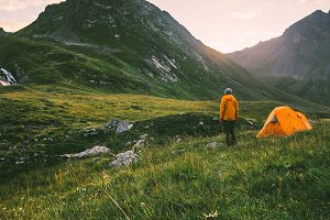 Camping in mountains man alone