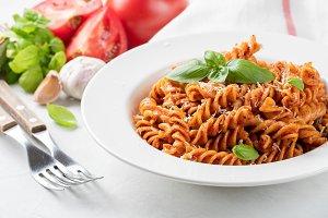 Fusilli pasta with tomato sauce, gar