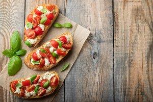 Bruschetta with tomatoes, mozzarella