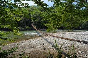 Suspension bridge through river