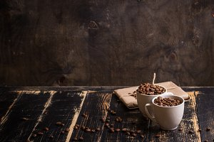 Cups with coffee beans background