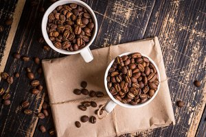 Coffee beans in a cups background