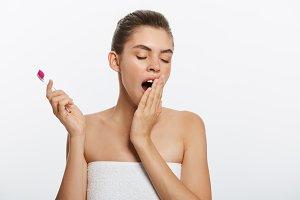 Sleepy woman, woman brushes teeth
