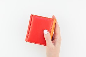 Woman hand with red wallet isolated