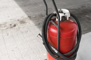 Red gas bottle cylinder with black
