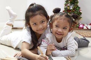 girls write wishes for Santa christm