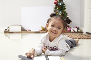 girl write wishes for Santa christma