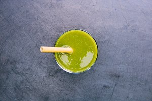 Green smoothie drink with straw