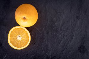 Fresh orange on dark background