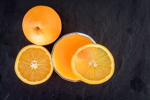 Fresh orange juice on dark backgroun
