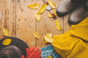Autumn warm clothes on wooden table