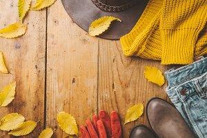 Autumn warm clothes on wooden
