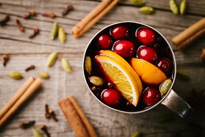 Mulled wine with fruits in old cup