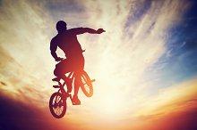 Man jumping on bmx bike