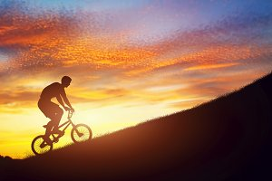 Man riding on a bmx bike uphill