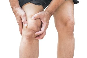 Man with knee pain isolated on white