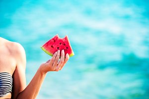 Watermelon slice in woman hand over