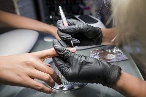 The manicurist makes pedicure