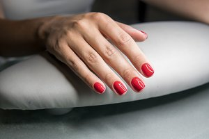 Beautiful female hands with red