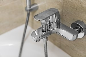 Shower and bath mixers in a bathroom