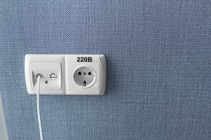 Socket on a blue wall, a